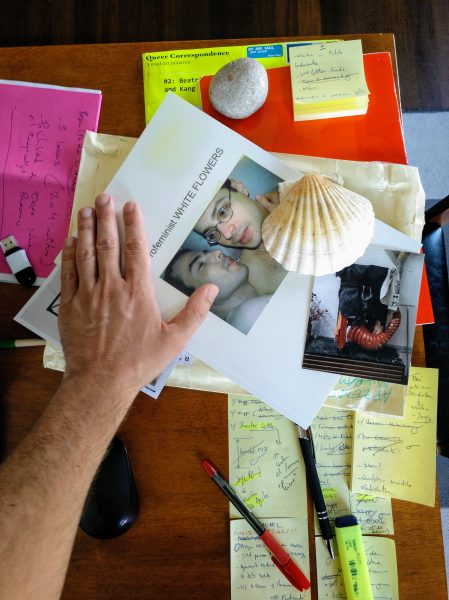 Digital photograph of Aimar's left hand touching Sands' book on Aimar's desktop sent to Sands as an email attachment on 15 August 2020.